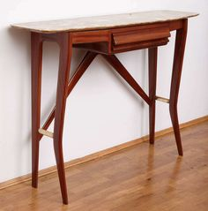 Italian 1950's  Four Legs Consolle. | From a unique collection of antique and modern console tables at https://www.1stdibs.com/furniture/tables/console-tables/