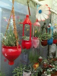 15 budget friendly diy backyard landscaping ideas to inspire you 00013 - Bottle Crafts Reuse Plastic Bottles, Plastic Bottle Crafts, Plastic Jugs, Diy Hanging, Hanging Plants, Recycling Containers, Recycled Garden, Recycled Art, Bottle Garden