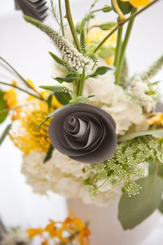 grey paper flowers and real flowers