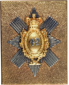 Victorian officer's gold gilt shoulder belt plate, pre 1881. Seeded gilt rectangular plate; mounted on the plate, a facetted silver Star of the Order of the Thistle; mounted on the Star, a gilt thistle wreath, within the wreath a Crowned oval bearing the motto of the Order of the Thistle (NEMO ME IMPUNE LACESSET) (No Person Shall Provoke Me With Inpunity). To the centre, the number 42 in silver, below the wreath, a gilt Sphinx.