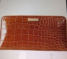 Kate Spade Chambers Street Lacey Wallet in Toasted Macaroon   Kate Spade Chambers Street Lacey Wallet in Toasted Macaroon patent crocodile embossed cowhide with matching trim custom woven bookstripe on poly twill lining 14-karat light gold plated hardware zip around continental wallet 12 credit card slots, 2 billfolds, zipper change pocket and exterior slide pocket 4''h x 7.6''w x 0.8''w imported  http://www.beststreetstyle.com/kate-spade-chambers-street-lacey-wallet-in-toasted-macaroon/