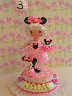 U Choose Hair Shade Minnie Mouse Cake by SweetiePieCaketopper...I've assembled wood parts to make the doll, stacked the wood bases, and additionally used different types of clay, fabric and paper. Everything has been hand sculpted, hand-painted, tightly secured and sealed with multiple high quality varnishes.