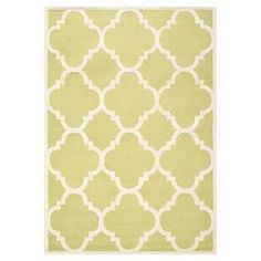 Hand-tufted wool rug with quatrefoil motif.  Product: RugConstruction Material: 100% WoolColor: Green and ivoryFeatures:  Made in IndiaHand-tufted  Note: Please be aware that actual colors may vary from those shown on your screen. Accent rugs may also not show the entire pattern that the corresponding area rugs have.Cleaning and Care: Professional cleaning recommended