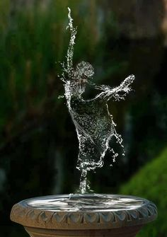 I do not know if photoshopped. Even so it is so beautiful. A water dancer. I looked more closely. I am pretty SURE it IS photoshopped.Still,it is a beautiful thought.