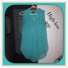High low top Cute sheer sleeveless collar high low top with a pocket on front. Could fit a large Tops