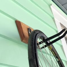 This vertical wall mount for your bike is sturdy and simple. Beveled edges and a solid wood mount give this bike hook character while keeping things sleek. Free Shipping.