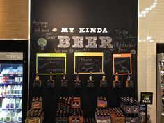 Beer zone in 7-Eleven with employee favorites and comments | '7-Eleven' Unveils Refreshed Logo And Store Design - DesignTAXI.com | chalk wall visual merchandising retail convenience grab-and-go NYC