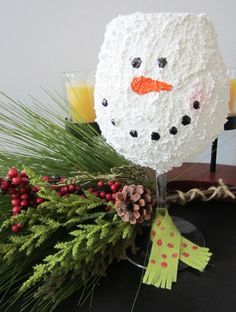 Snowman Wine Glass Tea Light Holder. Really cute idea. Use snow tex to spray the wine glass, let it dry then add a face with markers. Pop in a tealight battery light.