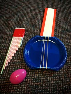 Music Day! I had the kids make plastic plate and rubber band guitars, straw panpipes, and plastic Easter egg shakers (filled with dried beans). The younger kids just had fun playing their instruments, but with the older kids we talked about pitch and how shortening a straw or tightening a rubber band makes a higher pitch and how lengthening a straw or loosening a rubber band makes a lower pitch.  Much fun!