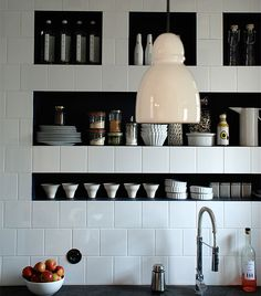 Great use of recessed shelving in the kitchen.