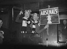 Arsenal F C supporters on the train at Euston Station on their way to support their team in an FA Cup tie against Burnley, 20th February 1937. (Photo by E. Dean/Topical Press/Getty Images)