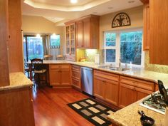 Large kitchen design with beautiful countertops and cabinets.-Home and Garden Design Ideas