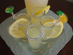 Lemon Drop Shots  ~ Ingredients ~ 12 ounces Can Frozen Lemonade Concentrate~2 ounces Bacardi Limon Rum ~1 ounce Absolut Citron Vodka ~ 4 whole Lemons (small), Divided 3 Tablespoons Sugar, Divided 1 cup Ice, Crushed