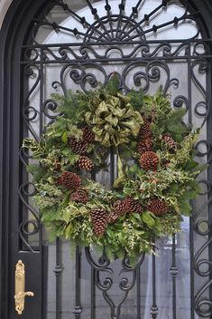 Christmas Wreath ~ Gorgeous gate, the simple wreath of greenery, pinecones and a bow are the perfect compliment~❥ Christmas Door Wreaths, Holiday Wreaths, Christmas Home, Christmas Holidays, Christmas Crafts, Christmas Decorations, Holiday Decorating, Christmas 2019, Christmas Ideas