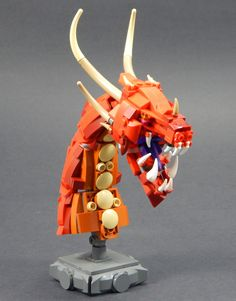 https://flic.kr/p/NdMgZt | Skrulk the Unkind | I build so many dragons-- so I decided it might be fun to try building one at a different scale! Meet Skrulk, an imposing fire dragon.  Look through the subsequent images' captions to find out more about this model and its build process.  Facebook Instagram