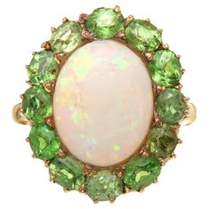 1900 Demantoid Garnet Opal Gold Ring  | From a unique collection of vintage cocktail rings at https://www.1stdibs.com/jewelry/rings/cocktail-rings/