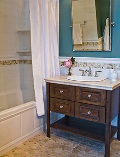 If you're looking to refresh your bathroom with a new paint job, the large number of color alternatives can be frustrating. These bathroom paint colors will certainly give your bathroom the makeover you've been waiting on, whatever your style. Master Bath Tile, Bath Tiles, Bathroom Floor Tiles, Bathroom Renos, Bathroom Renovations, Small Bathroom, Warm Bathroom, Bathroom Storage, Mosaic Tiles