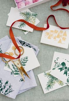 DIY hostess gifts (inexpensive) that range from floral napkins to holiday greeting cards with a holiday cookie book and more. #hostessgifts #diygifts #Holiday