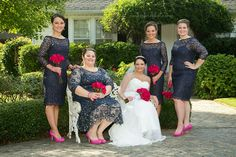 Bridesmaids in navy with pink flowers