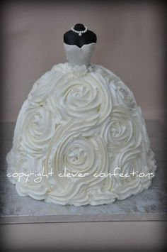 "Wedding Gown Cake Gown is 9"", 8"", 8"", 6"" cakes, stacked and carved slightly; crumb-coated and then covered with..."