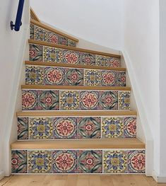 Add color to your stairs with this tile stripe. The classic color palette features indigo, deep red, and forest green. #windowfilmworld #windowfilm #walldecor #stickwallpaper #homedecor #homedesign