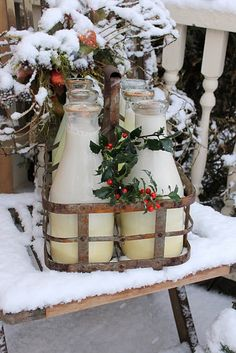Vintage milk jars outside - cookies for Santa inside.