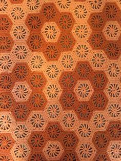 Afghan Blanket with Pinwheel Hexagons in a Beehive Pattern by HautelAudubon on Etsy https://www.etsy.com/listing/454825320/afghan-blanket-with-pinwheel-hexagons-in