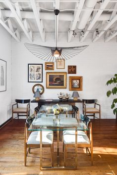 This eclectic dining room uses art from the couples travels and a unique fan we've never seen before.