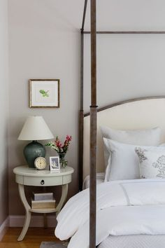 The four poster frame helps fill up the large master bedroom, and also succeeds in making the bed (and, as such, relaxation) the star of the room.