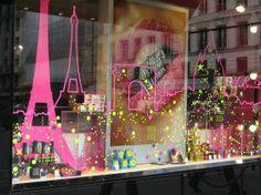 Eiffel Tower looking pretty in Pink (window shopping in Paris) http://newplacesnewexperiences.wordpress.com/
