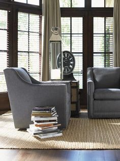 Bring a touch of contemporary style to your home with the Barrier swivel chair. Clean lines give this chair a simple, modern shape that would match with almost any design decor. The chair sits on a swivel base, making it easy to face the chair in any direction you choose. Set the arm chair in your living room, family room or den to use as a stylish accent chair.