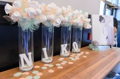 Baby Shower Decor. Diaper Bouquet. Peach, Mint Green, All White attire. Baby Pins & Sand