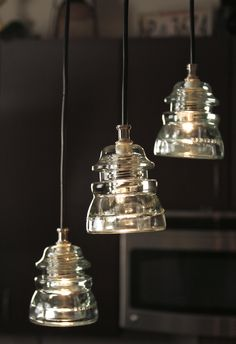 3 Light Repurposed Glass Insulator Pendant Light --Kitchen sink If you come across any insulators. Pendant Lighting Bedroom, Kitchen Pendant Lighting, Kitchen Pendants, Glass Pendants, Pendant Lights, Linear Chandelier, Pendant Lamp, Antique Lighting, Rustic Lighting