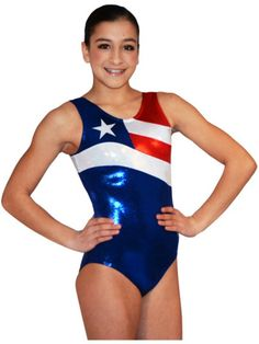 Glory Leotard Capture the GLORY!!!  This beautiful leotard is made from a vibrant navy/royal mystique. The stripes are made from a crisp red mystique and a white hologram with stars adorning it. The bottom silver stripe goes around the entire body. Top off the design with a silver mystique star and you have a real winner. Check out the matching doll/bear leotard to complete your set. All leotards come with a matching scrunchie.