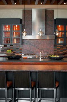darker desert palette with Red Dragon granite and Wingate black cabinetry--interior design: David Michael Miller Associates