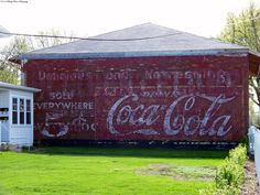 A Coca-Cola advertisement on an abandoned brick building in Waterloo, Iowa. 3/28/12
