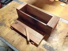 This is a clever way to add a locking mechanism to a Japanese-style toolbox. Clay Gossage was kind enough to send these photos of how he incorporated a wedge with a dovetail profile to lock the lids...