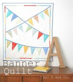 This pennant bunting quilt would be adorable in a baby's or child's room, whether for functional or decorative use.