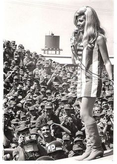 Nancy Sinatra on stage in front of the 1st Infantry, US Army, Vietnam, 1967.