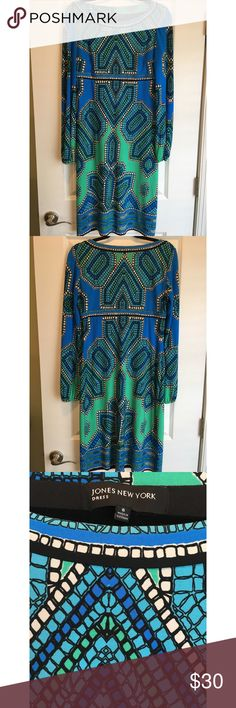 Jones New York Dress Jones New York is generally not my style, but this dress was love at first sight. The colors are very saturated and the print is beautiful. Looks great on too. Falls a little below the knee. Gently worn. Jones New York Dresses