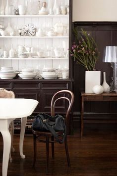 black/white cabinet, bentwood chairs, white table.