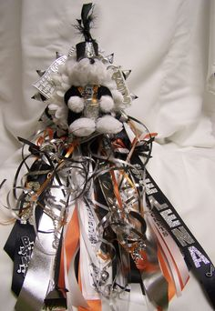 Alvin band Bear homecoming mum!! Made by All That Glitters Flowers.