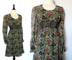 Vintage 70s Poet Sleeve Floral Dress Smocked Waist and Wrists. $48.00, via Etsy.