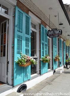 Love the New Orleans inspired exterior shutters that run the full