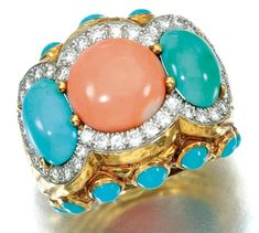 Ring by David Webb with coral and turquoise cabochons, within a border of brilliant-cut diamonds.
