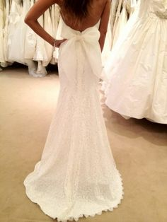 Low back lace wedding dress, with large bow.