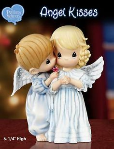 Precious Moments Angel Kisses Child Angel Figurine... collect these!!