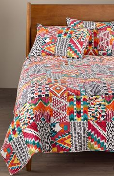 Free shipping and returns on Levtex 'Nyla' Reversible Quilt at Nordstrom.com. A bold and colorful patchwork design adds a globally inspired vibe to this reversible, channel-stitched quilt crafted from pure cotton.