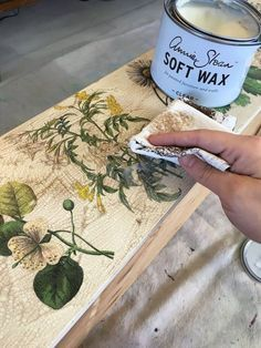 on top of base paint and applied design (painted or decopage, etc.)a layer of Annie Sloan Step 2 Craqueleur. For more noticeable cracks, apply the product thickly.  use hair dryer to speed up drying process & help define the cracks.  crackled effect. show with dark wax applied after