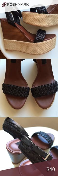 WHBM Wedge Sandal Never worn.  Black leather straps with brown sole and woven beige wedge.   Toe to floor is about 1.5 inches and heel to floor is about 4.5 inches.  Beautiful! White House Black Market Shoes Wedges